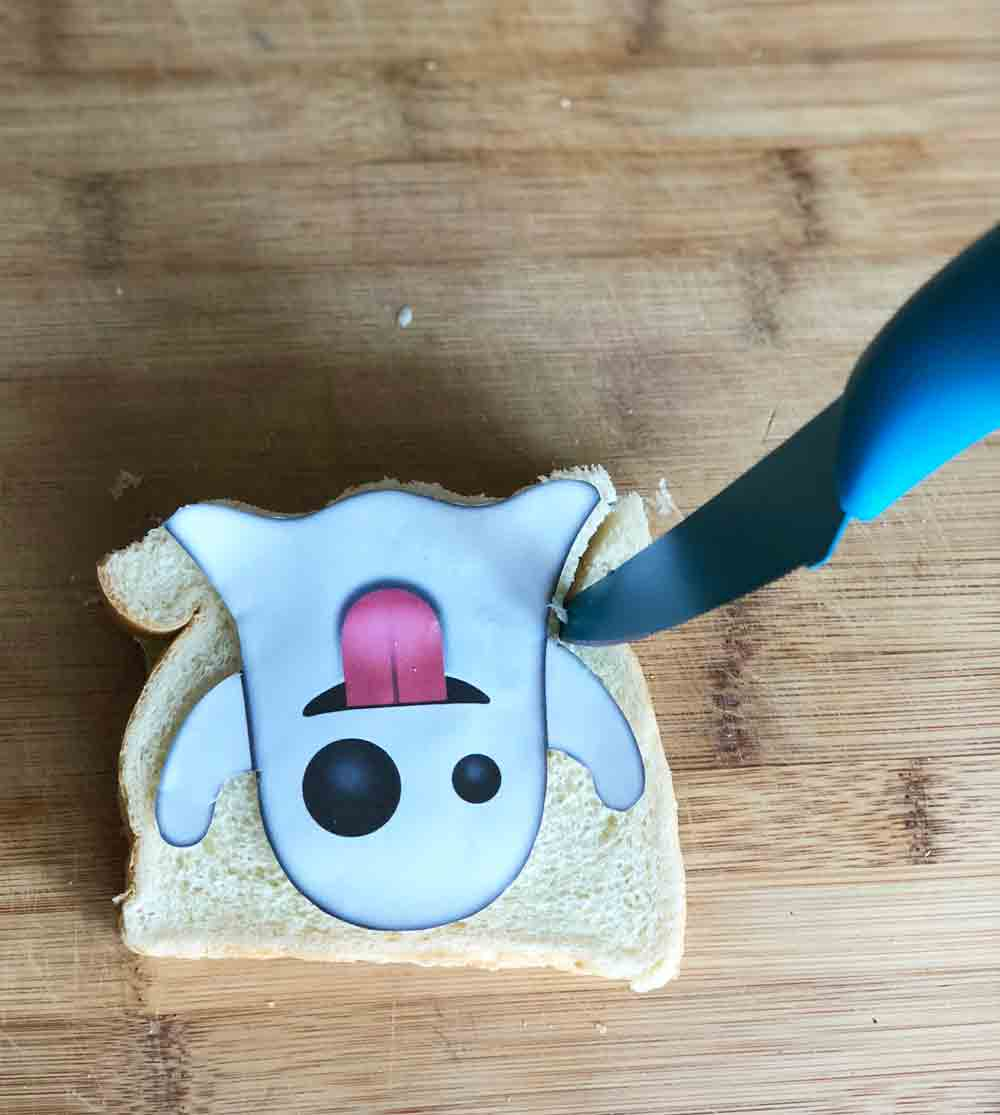 cutting out vegan ghost emoji tea sandwiches