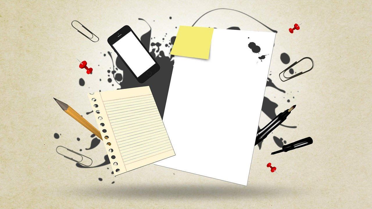 picture of paper, pens, and phone