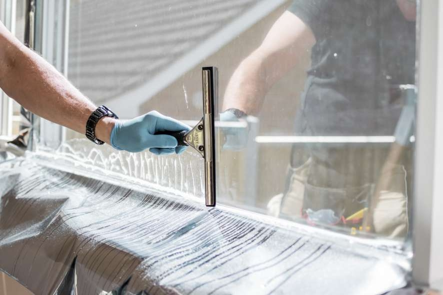 Window being tinted using dark UV protection film