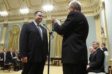Hon James Moore being sworn in as new Minister of Industry. The Globe and Mail reported Ministers with new portfolios were given 'enemy lists' during this federal cabinet shuffle.