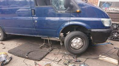 Welding being carried out on a blue van