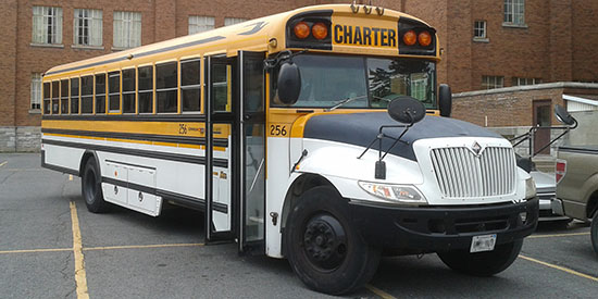 Photo of one of the school buses we chartered to run the service