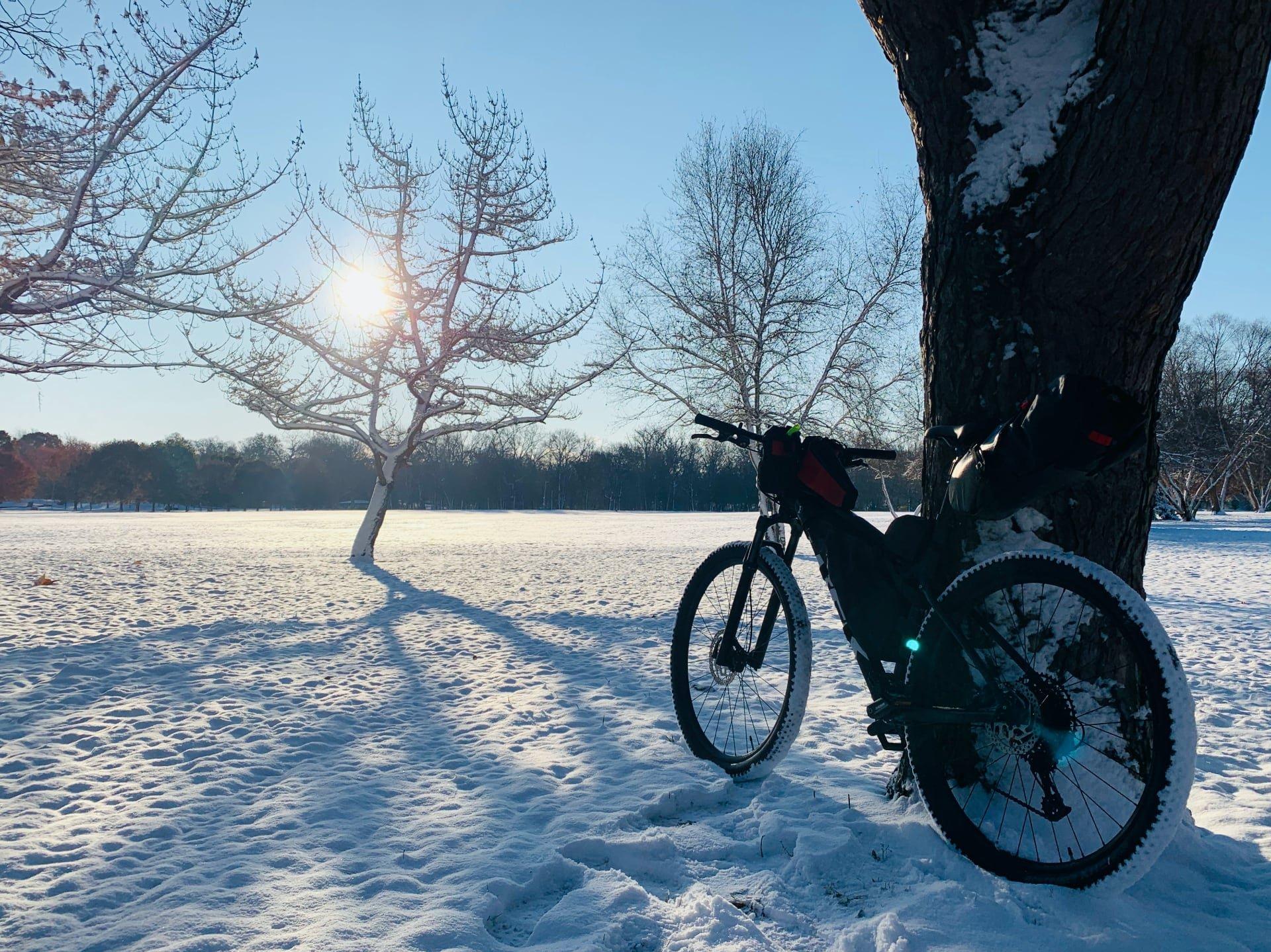 The new mountain bike riding through snow