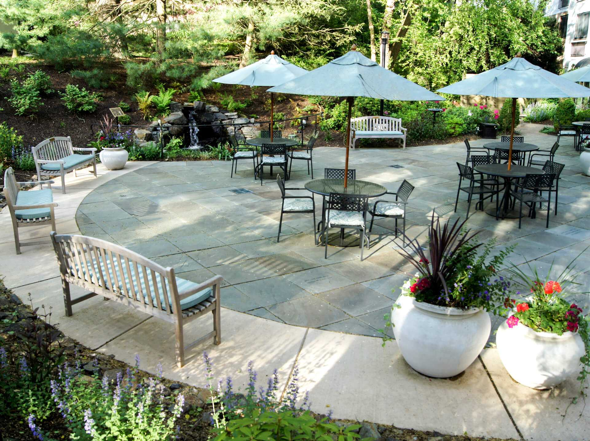 Rosemont outdoor dining area surrounded by landscaping and bench seating