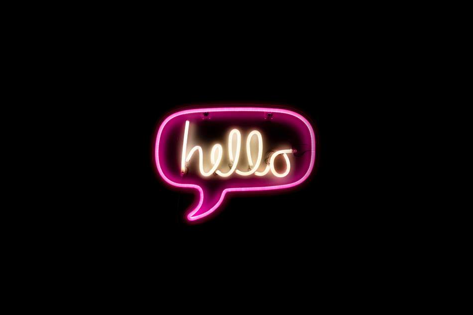 An image of a neon sign saying hello, about ten Squared, get in contact with a next generation website developer in Melbourne,