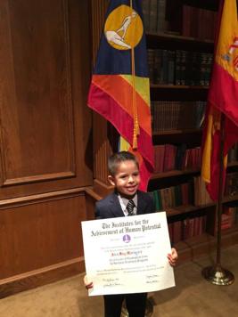 autism-signs-alex-graduation