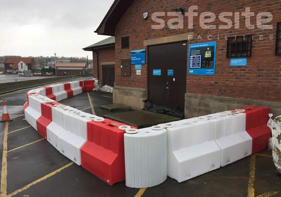 900mm flood barrier protecting building