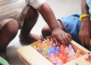 Child picking crayons
