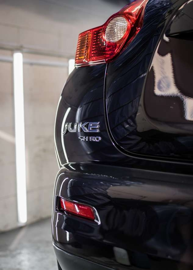 Close up shot of shiny paintwork of black Nissan Juke car after paint correction, paint correction, paint enhancement and ceramic coating
