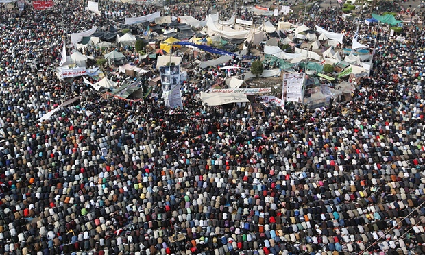 People take part in Friday prayers in Tahrir Square before a mass rally on 25 November 2011 ahead of parliamentary elections. Photograph: Peter Macdiarmid/Getty Images
