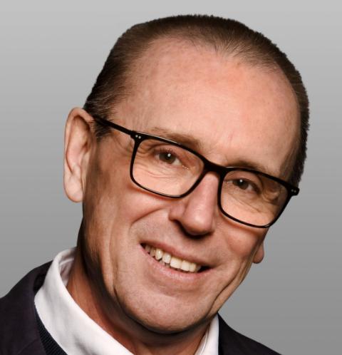 AQA CEO Colin Hughes Profile Picture