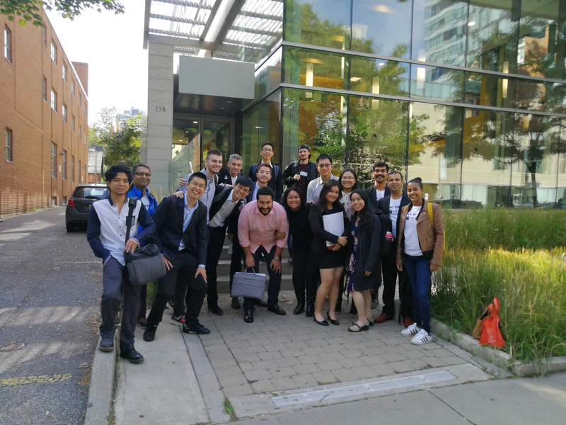Students outside of a building outside of a University of Toronto boot camp