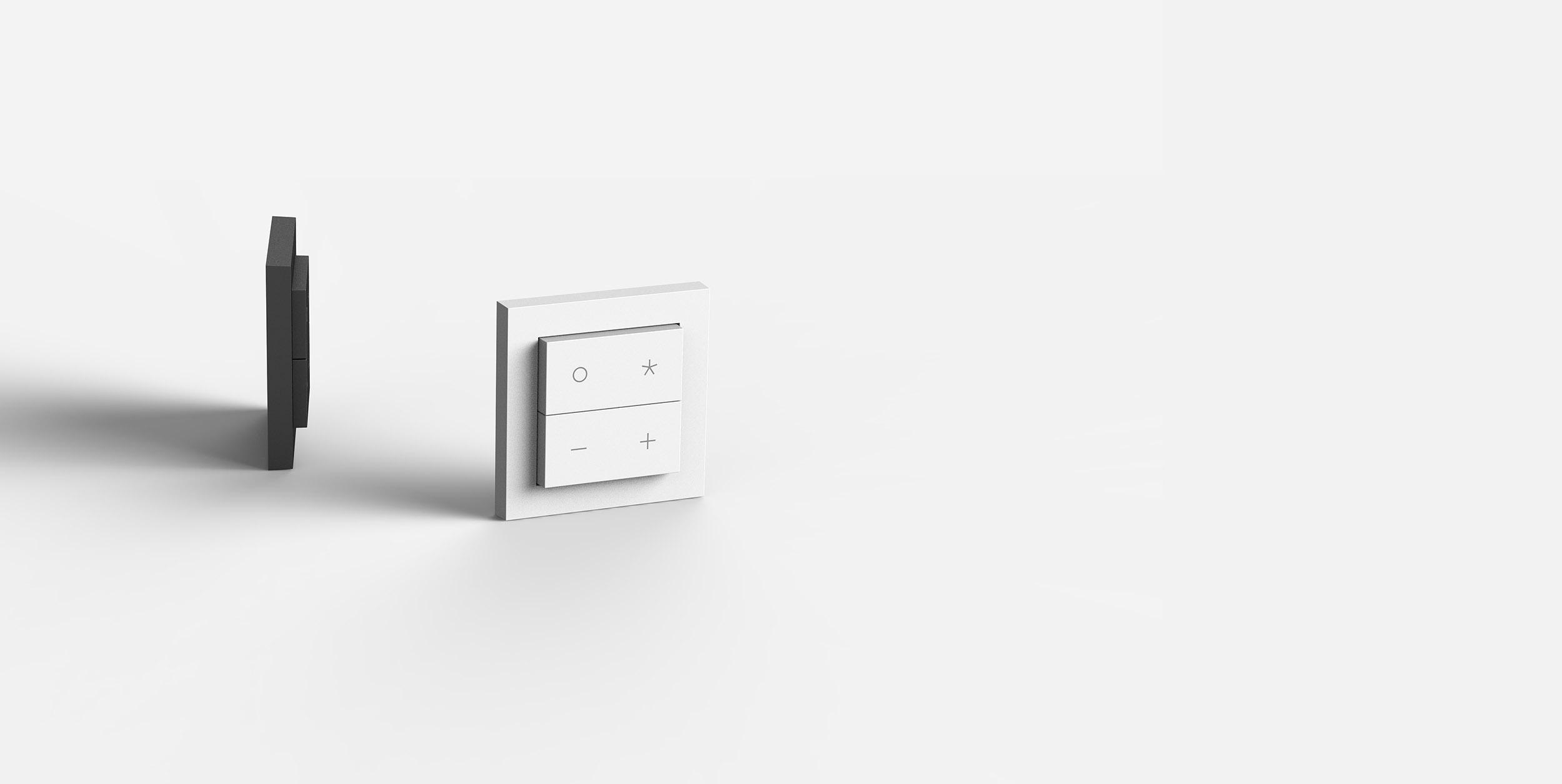 Nuimo Click Schwarz und Weiß auf einem weißen Hintergrund