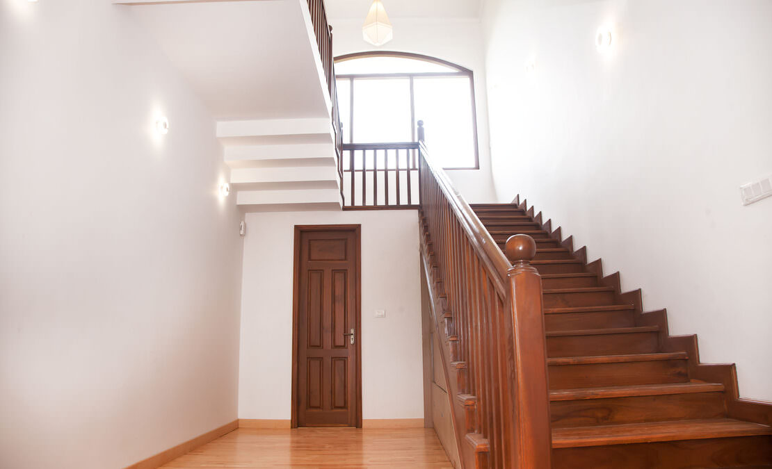 The foyer with a staircase to go to the upper level