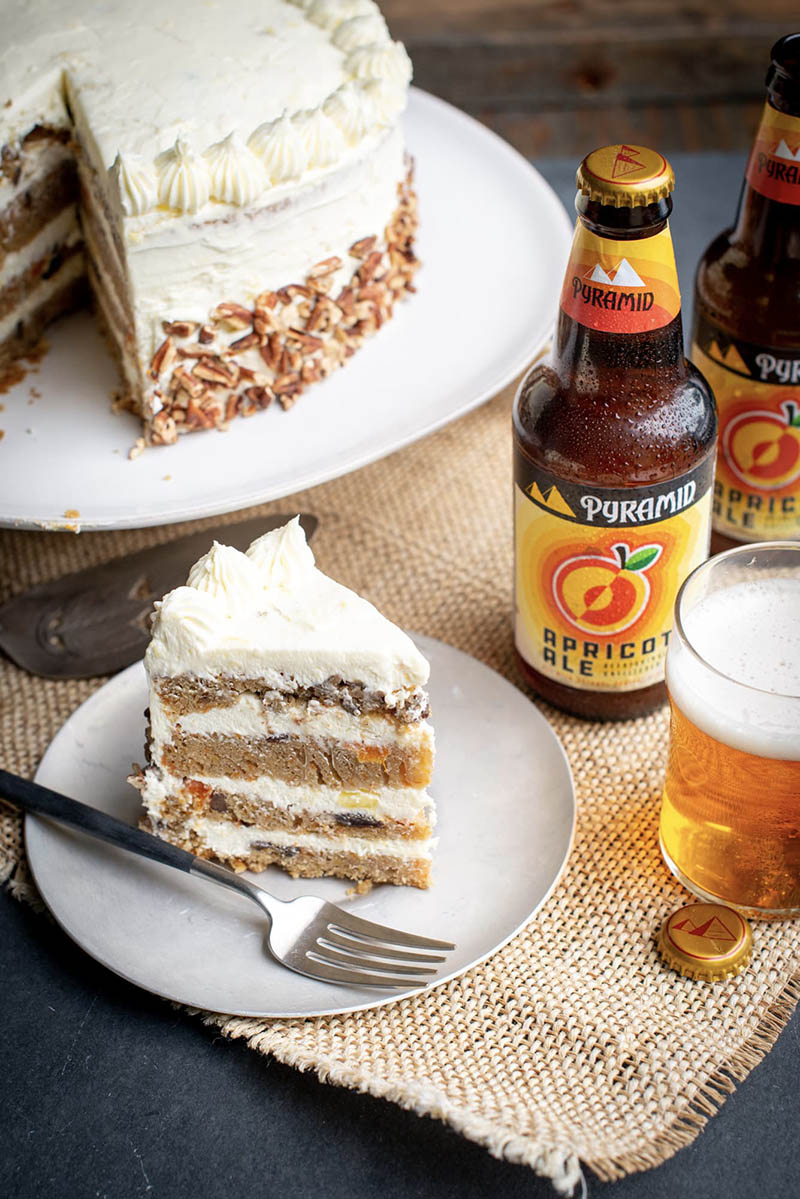 Closeup shot of a homemade, 4 layer apricot-ale carrot cake made with Pyramid's apricot ale and a pineapple creamcheese frosting.