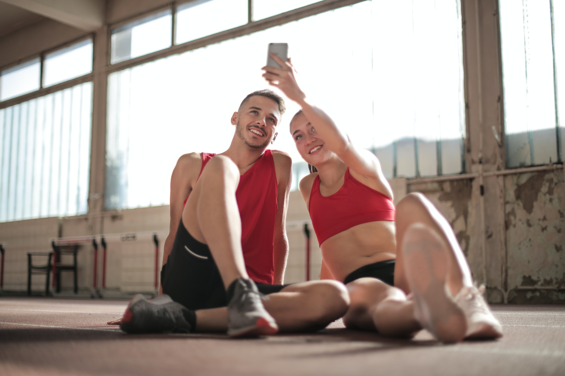 Couple smiling at phone and taking pictures