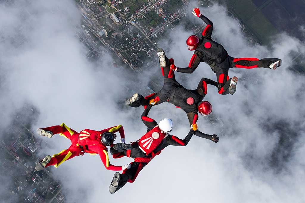 Skydivers in mid air formation