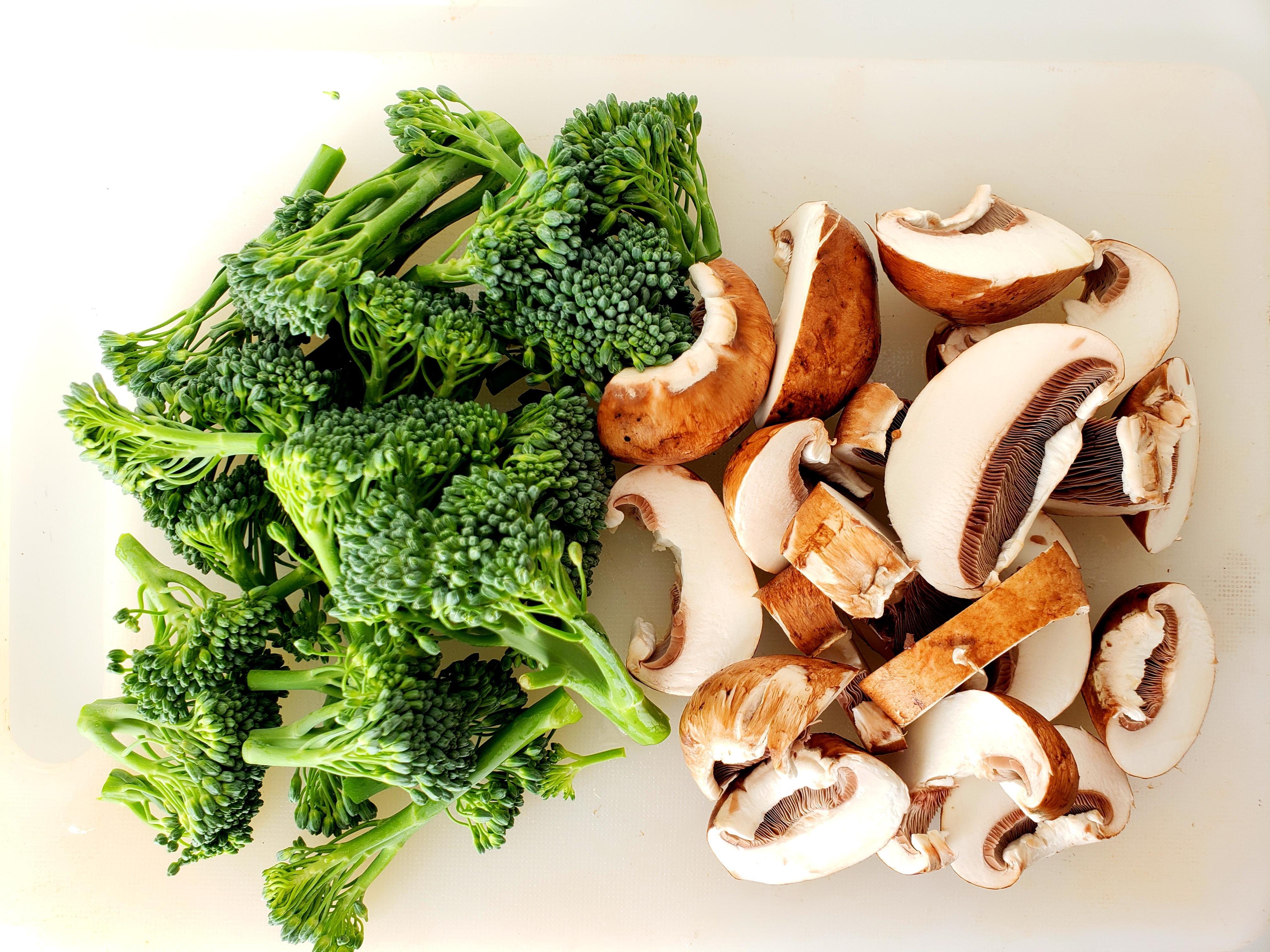 Sliced mushrooms and chopped broccolini