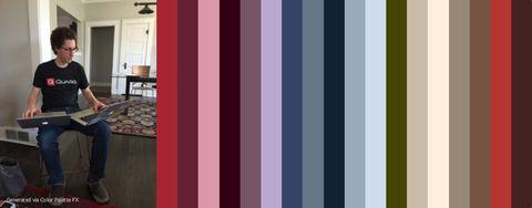 Jonny next to vertical stripes of color