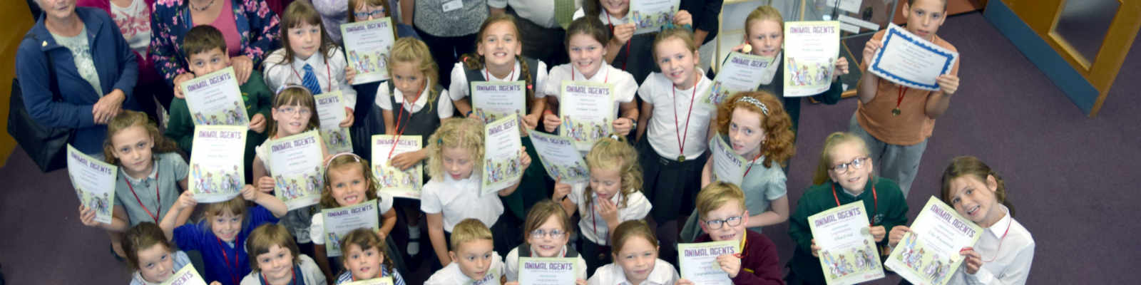 Children at Halesworth Library with their Summer Reading Challenge certificates