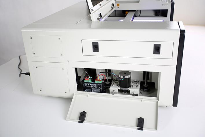 left panel opened, on the Aeon Mira CO2 Desktop Laser Cutting Machine