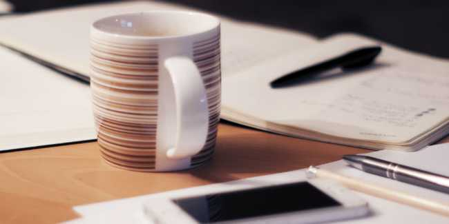 Cup with table and paper