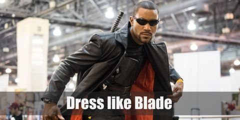 Blade has a 90's superhero touch to his iconic look. He wears a dark armor vest with black tactical pants, leather gloves and shoes, dark sunglasses, and a leather long coat.