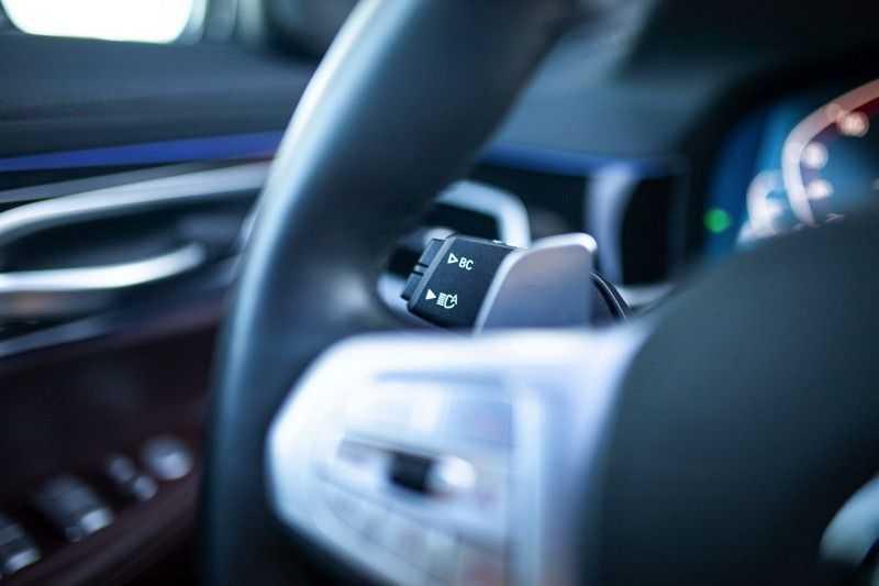 BMW 7 Serie 740d xDrive *Schuifdak / H&K / Memory / LED / ACC / Stoelventilatie* afbeelding 11