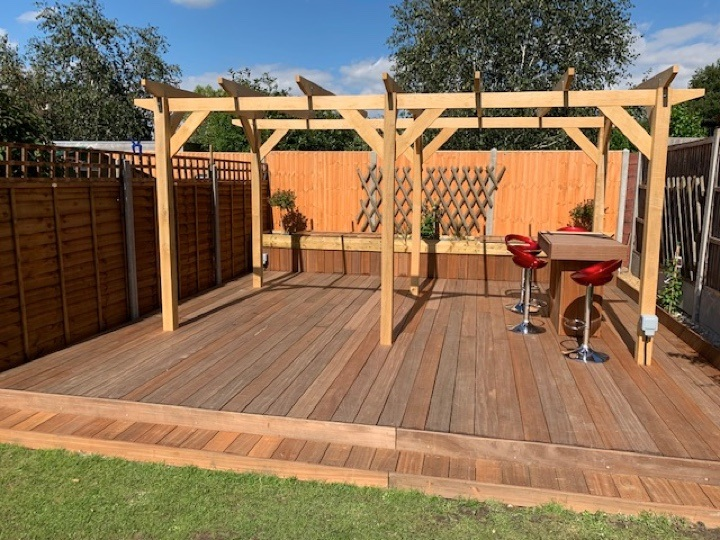 A module 5 pergola in oak, constructed on decking for a unique outdoor entertaining space