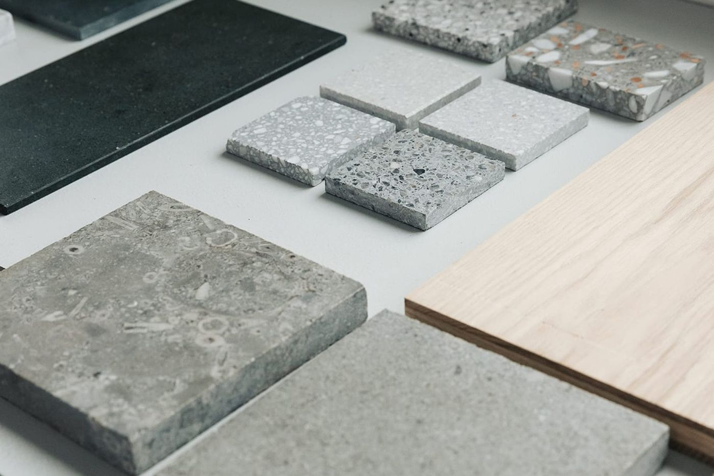 Natural stone, terrazzo, steamed beech timber and woven carpet material samples in From Works studio.