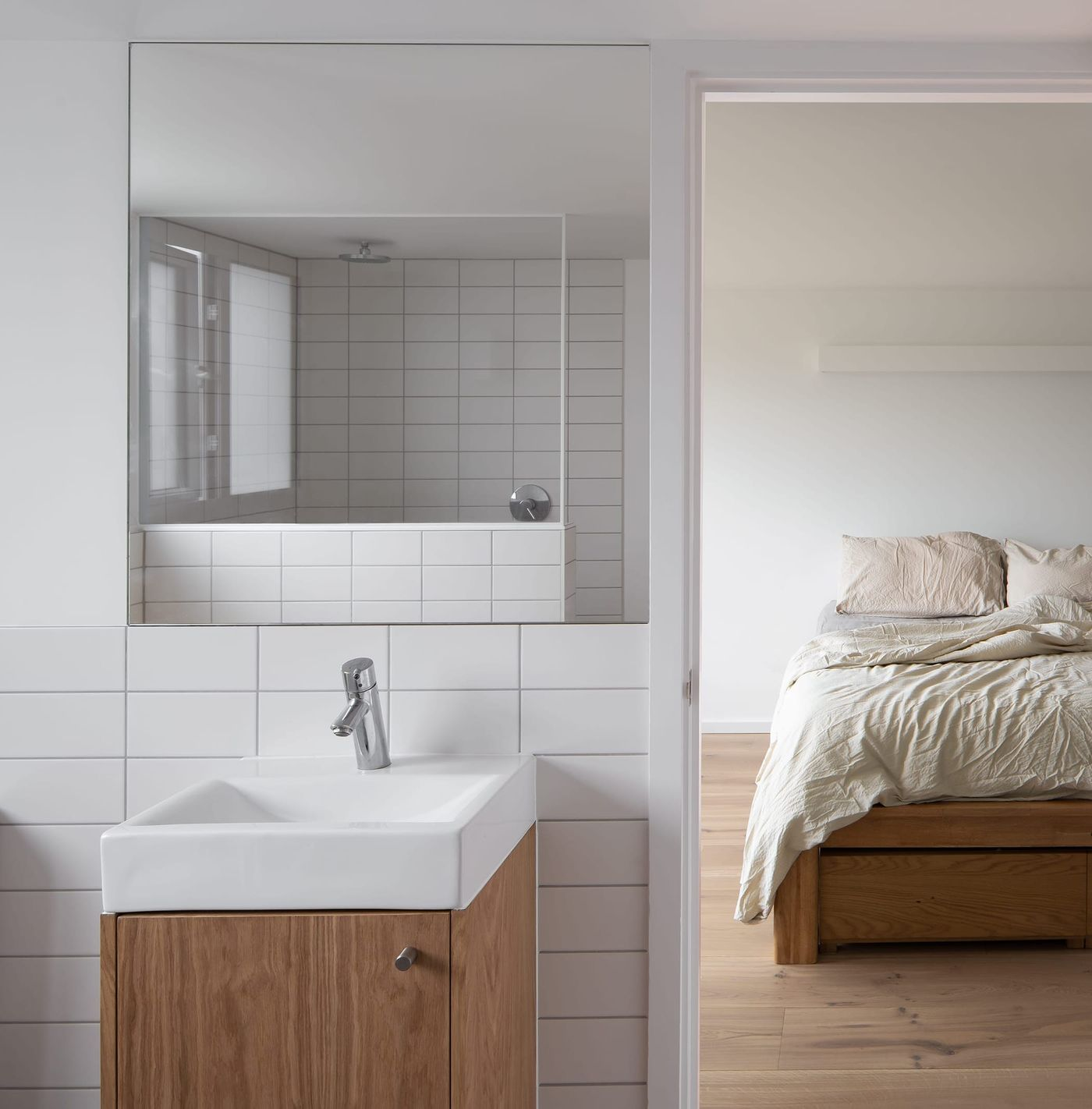 Ensuite bathroom and master bedroom suite within From Works loft conversion and rear dormer extension in Blackheath, London.