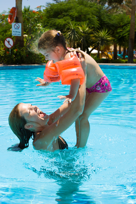 woman and child in pool