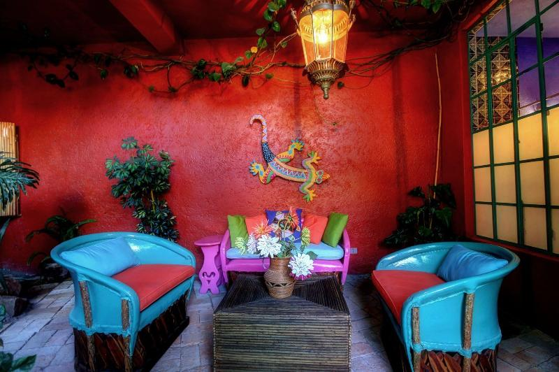 The Guitar nook behind the tree off the patio is one of many private spaces in Casa del Alma.