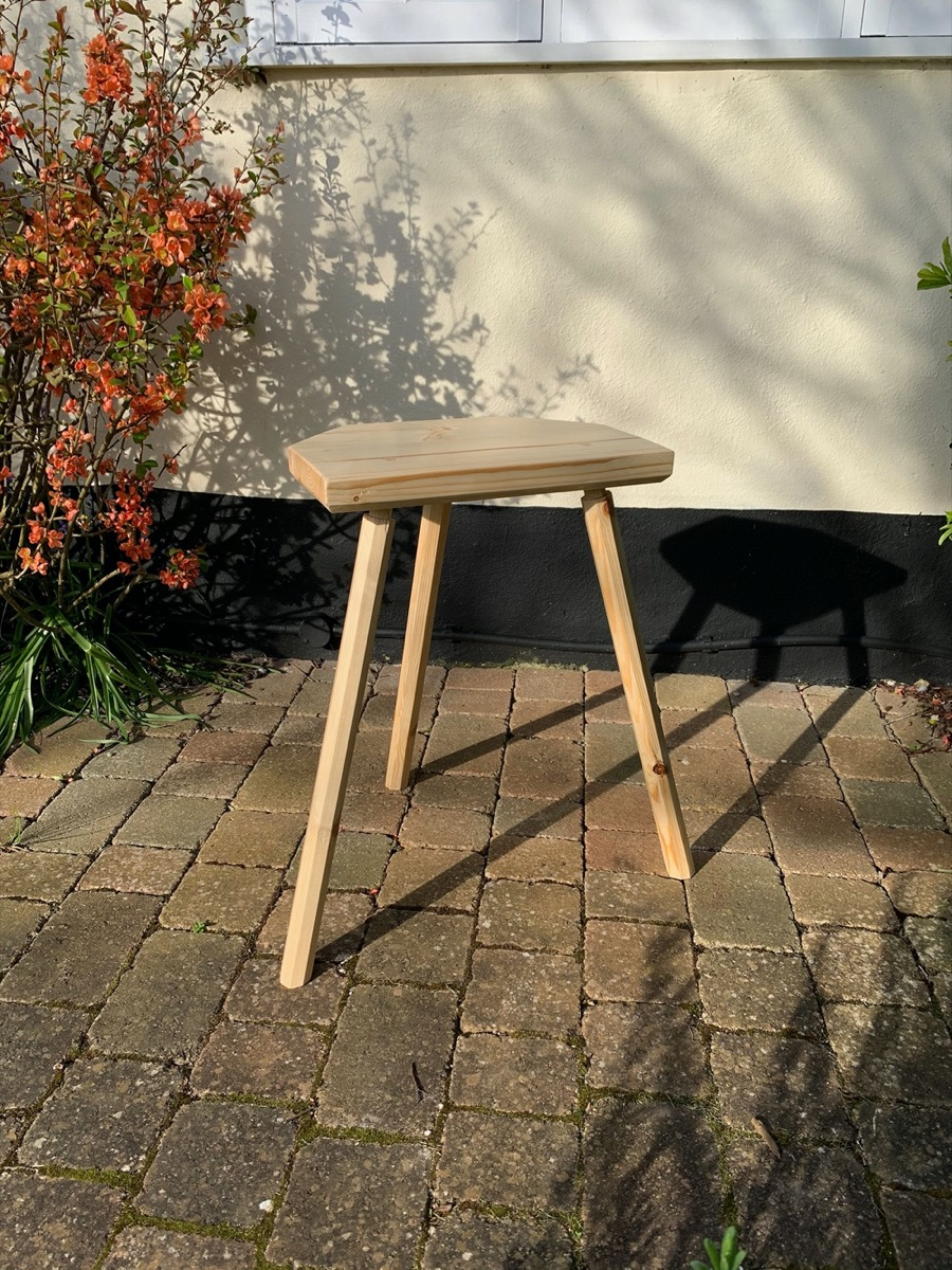 Pegged mortise stool outside with flowers
