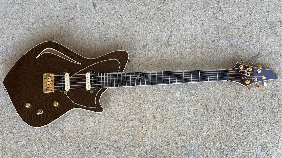 Custom electric guitar on concrete