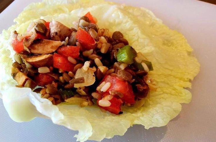 Cabbage leaf with lentil, rice filling on top