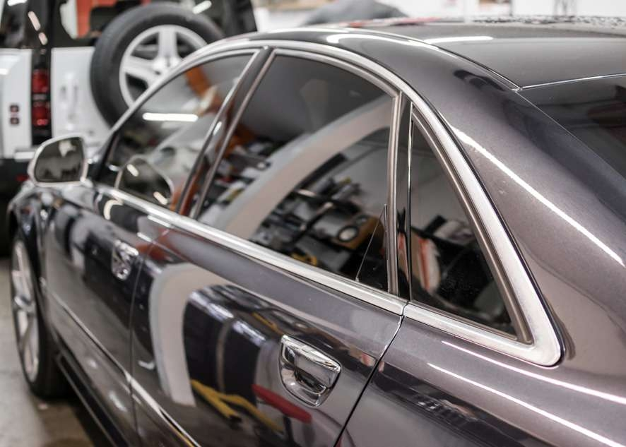 Audi s8 car with tinted windows from side close shot
