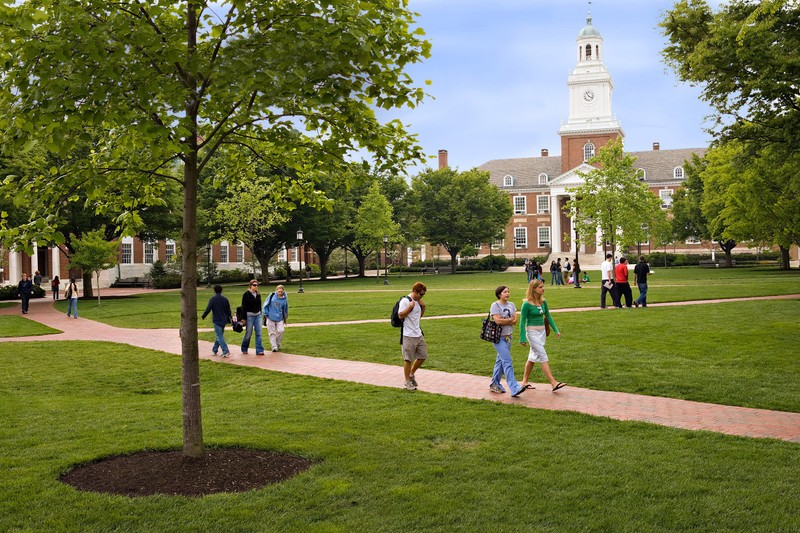 Students walking on the quad on a sunny day at Johns Hopkins University