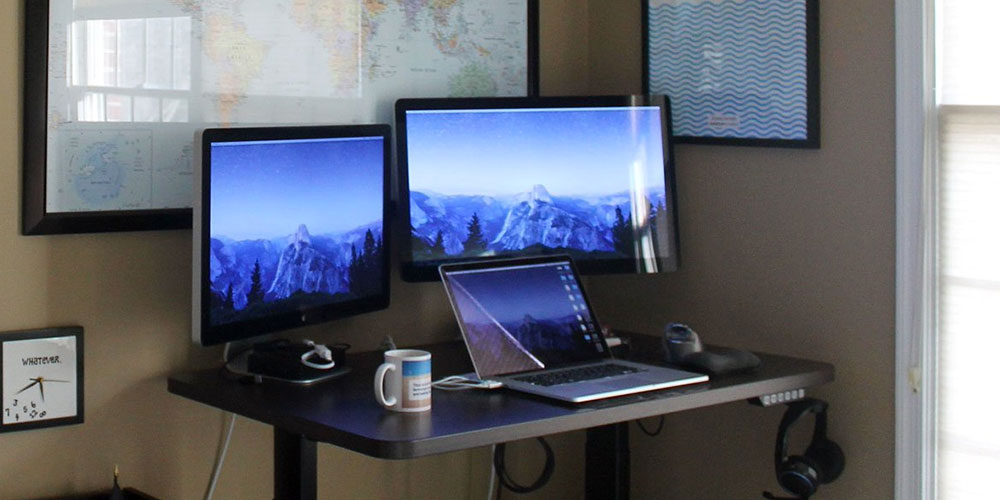 My standing desk with MacBook Pro and two external displays.