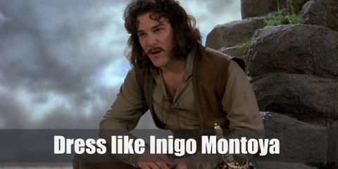 Inigo Montoya looks very much like a medieval man who prefers the color brown. He has on a cream tunic, a brown vest, brown pants, and brown boots. Plus, he always has his sword on hand.