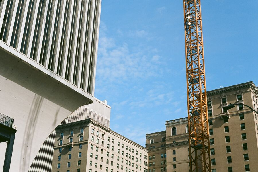 Various buildings and a construction crane