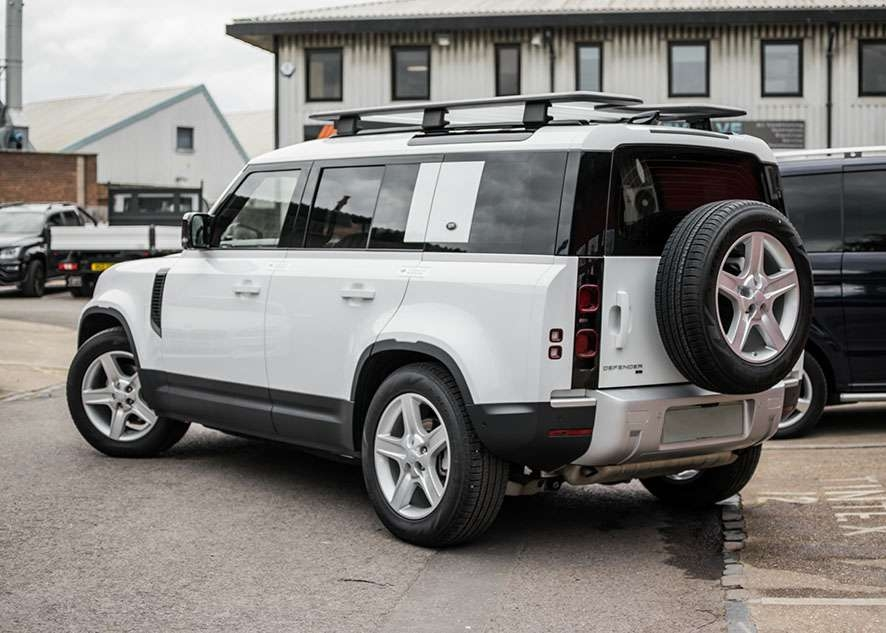 White Land Rover Defender rear and side windows tinted after window tinting