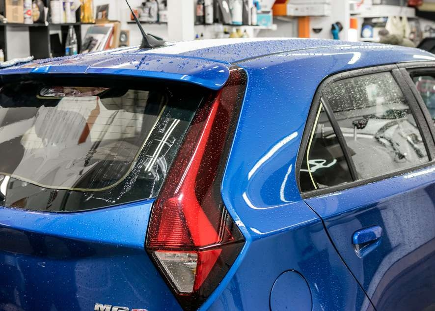 Blue MG3 car untinted rear window before window tinting