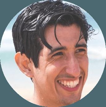 A headshot of Alex Espinoza