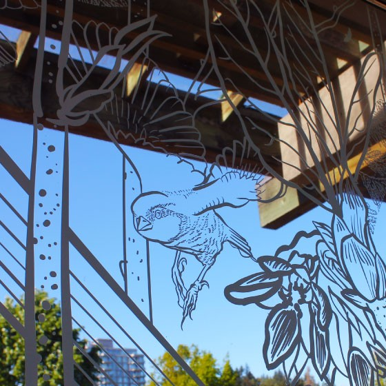 A detail of a windows at the UBC Botanical Gardens, which have been covered in artistic decals to prevent birds from flying into them