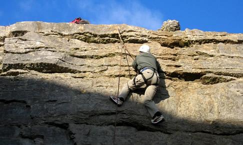 Me, half way up a rock race in Wales