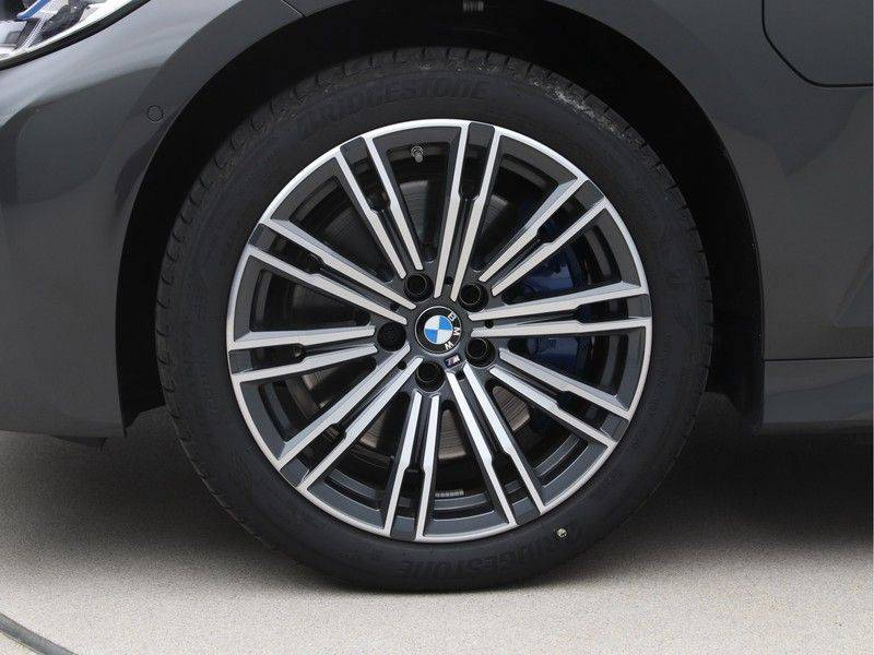 BMW 3 Serie Touring 330e xDrive High Executive Model M Sport afbeelding 24