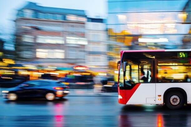bus speeding through an intersection in new york city