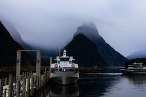Boardwalk to a cruise waiting in Milford Sound with Overhanging clouds and moody weather