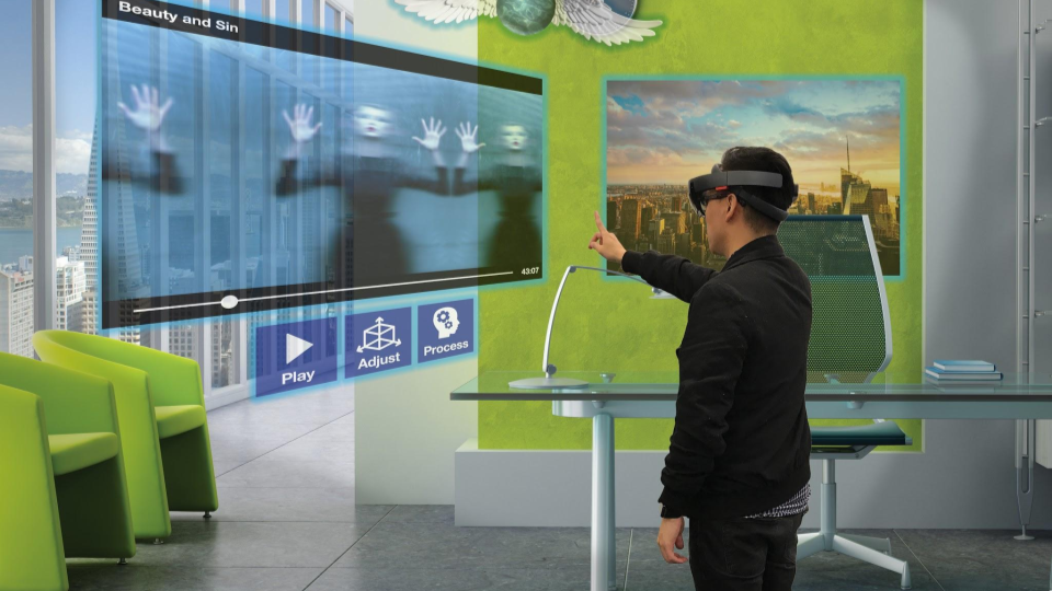 Render of a person watching a video in the Holostudio. Controls are visible under the video